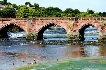 Chester, UK - July 22, 2014 - View of Old Dee Bridge along the River Dee, Chester, Cheshire, England, UK, Western Europe.