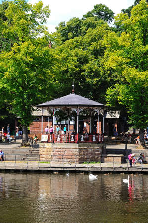 bandstand: Chester, UK - July 22, 2014 - Bandstand on the River Dee Embankment with people enjoying the view, Chester, Cheshire, England, UK, Western Europe.