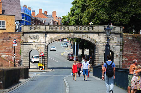 Chester, UK - July 22, 2014 - Bridge over River Dee along Lower Bridge Street looking through City Wall arch, Chester, Cheshire, England, UK, Western Europe.