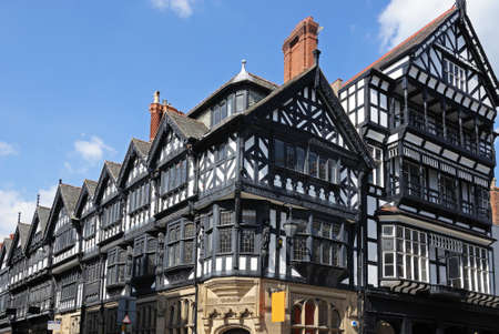 Tudor buildings on the corner of Eastgate Street and St Werburgh Street, Chester, Cheshire, England, UK, Western Europe.