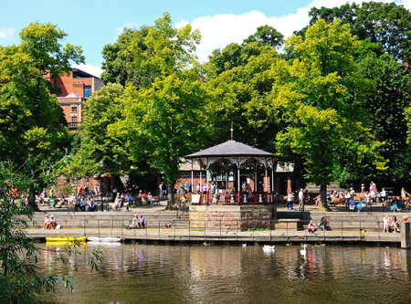 Bandstand on the River Dee Embankment with people enjoying the view, Chester, Cheshire, England, UK, Western Europe.