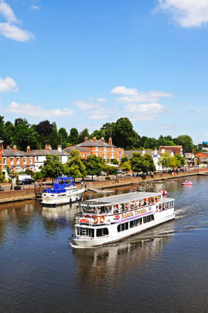Chester, UK - July 22, 2014 - River ferry and boats along the River Dee, Chester, Cheshire, England, UK, Western Europe.