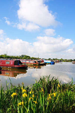 moorings: Barton-under-Needwood,m UK - May 21, 2014 - Narrowboats on their moorings in the canal basin, Barton Marina, Barton-under-Needwood, Staffordshire, England, UK, Western Europe. Editorial
