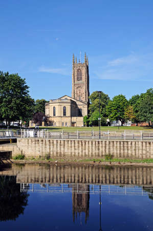 perpendicular: Derby, UK - July 17, 2014 - The Cathedral of All Saints seen from across the River Derwent, Derby, Derbyshire, England, UK, Western Europe.
