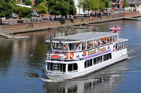 Chester, UK - July 22, 2014 - River ferry and pedalo on the River Dee, Chester, Cheshire, England, UK, Western Europe.