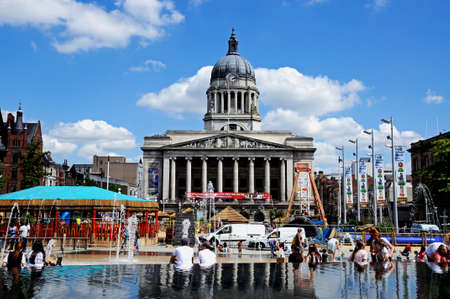 pool hall: Nottingham, United Kingdom - July 17, 2014 - Council House also known as the city hall in the Old Market Square with a pool and fountain in the foreground, Nottingham, Nottinghamshire, England, UK, Western Europe. Editorial