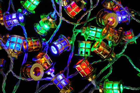 Modern Christmas LED Lantern lights against a black .