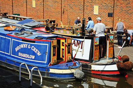 canal lock: Nottingham, UK - July 17, 2014 - Narrowboats in the canal lock under Wilford Street bridge along the Nottingham and Beeston Canal, Nottingham, Nottinghamshire, England, UK, Western Europe. Editorial