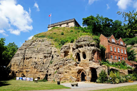 Nottingham, UK - July 17, 2014 - View of the castle on top of the castle mound caves in castle rock, Nottingham, Nottinghamshire, England, UK, Western Europe. Editorial