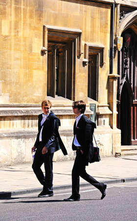 academic dress: Oxford, UK - June 17, 2014 - Students walking along the High Street wearing academic dress, Oxford, Oxfordshire, England, UK, Western Europe. Editorial