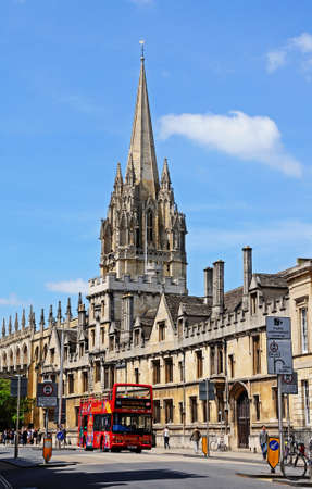 open topped: Oxford, UK - June 17, 2014 - All Souls College and the spire of the University Church of St Mary to rear along High Street, Oxford, Oxfordshire, England, UK, Western Europe.