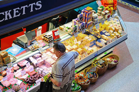 Derby, UK - July 17, 2014 - Elevated view of a butchers market stall inside the restored Victorian Market Hall, Derby, Derbyshire, England, UK, Western Europe.