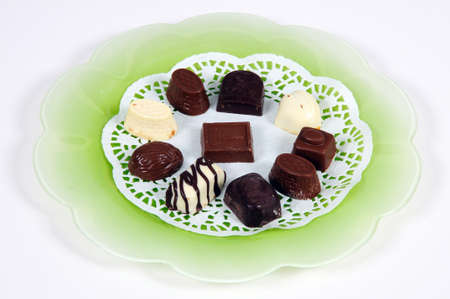 mementos: Selection of Belgian chocolates on a green plate. Stock Photo