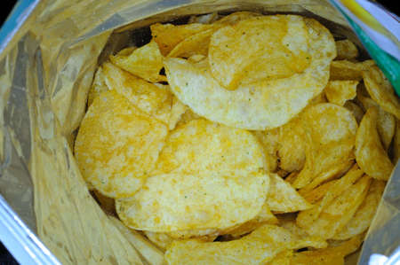 flavoured: Tomato and garlic flavoured crisps. Stock Photo