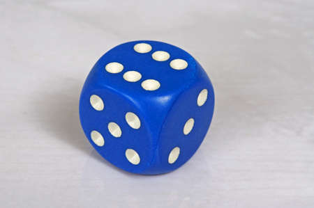 Platonic regular 6 sided blue die with white pips, England, UK, Western Europe.