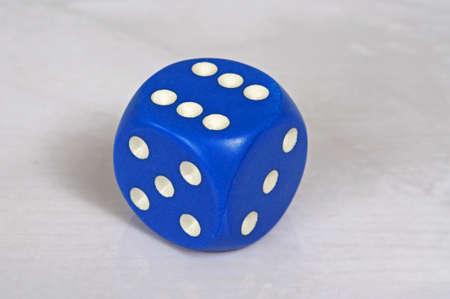 pips: Platonic regular 6 sided blue die with white pips, England, UK, Western Europe.