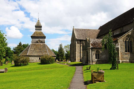 View along the side of St Marys church towards the separate bell tower, Pembridge, Herefordshire, England, UK, Western Europe.