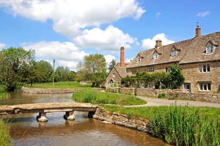 Cotswold cottages alongside the river Eye, Lower Slaughter, Cotswolds, Gloucestershire, England, UK, Western Europe. photo