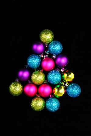 plastic christmas tree: Colourful plastic Christmas baubles in a Christmas tree shape.