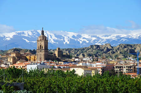 sierra snow: View of the town and Cathedral with the snow capped mountains of the Sierra Nevada to the rear, Guadix, Granada Province, Andalucia, Spain.