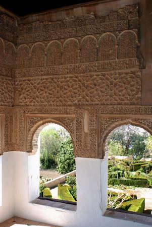 View through Moorish windows of the Generalife, Place of Alhambra, Granada, Granada Province, Andalucia, Spain, Western Europe. photo