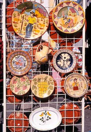 mementos: Decorative ceramic plates for sale, Evora, Alentejo region, Portugal, Western Europe.