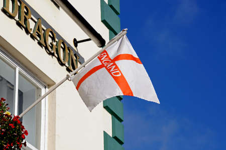 market place: Ashbourne, UK - September 7, 2014 - English flag on the George and Dragon in the Market Place, Ashbourne, Derbyshire, England, UK, Western Europe.