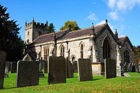 churchyard: Ashford-in-the-Water, UK - September 7, 2014 - Holy Trinity Parish Church and churchyard, Ashford-in-the-Water, Derbyshire, England, UK, Western Europe.
