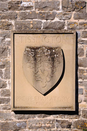 preparatory: TISSINGTON, UK - SEPTEMBER 7, 2014 - Tissington Hall plaque on the pre-preparatory school building, Tissington, Derbyshire, England, UK, Western Europe.