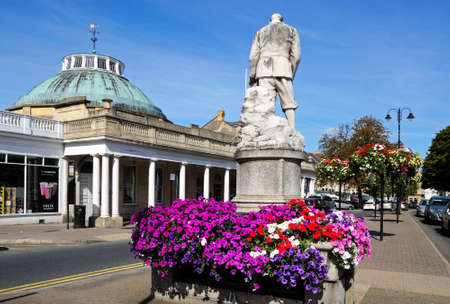 bank western: Cheltenham, UK - September 8, 2014 - View of the Montpellier Rotunda which was formerly a Spa building and is now Lloyds Bank with a statue in the foreground, Cheltenham, Gloucestershire, England, UK, Western Europe. Editorial