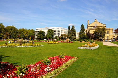 gloucestershire: Cheltenham, UK - September 8, 2014 - Flowerbeds in the Imperial Gardens with the town hall on the right hand side, Cheltenham, Gloucestershire, England, UK, Western Europe. Editorial