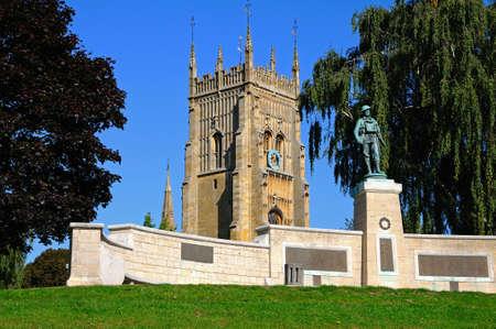 worcestershire: Evesham, UK - September 8, 2014 - Evesham War Memorial in Abbey Gardens with the Abbey clock tower to the rear, Evesham, Worcestershire, England, UK, Western Europe.