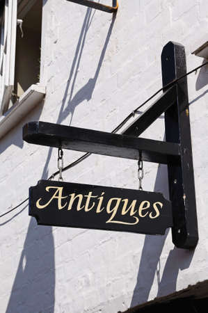 gb: Old rustic antiques sign on a Tudor building, Tewkesbury, Gloucestershire, England, UK, Western Europe.