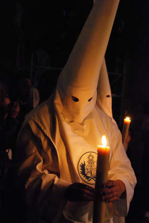 holy week in seville: Seville, Spain - April 7, 2009 - Members of the Candelaria brotherhood at night during Santa Semama, Seville, Seville Province, Andalusia, Spain, Western Europe. Editorial