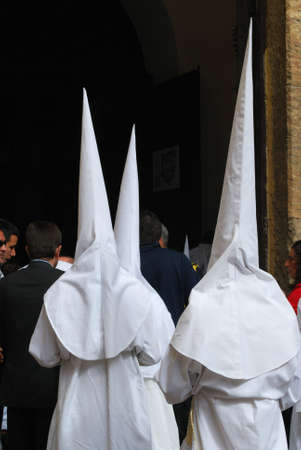 brotherhood: Seville, Spain - April 7, 2009 - Members of the Candelaria brotherhood entering the church during Santa Semama, Seville, Seville Province, Andalusia, Spain, Western Europe. Editorial