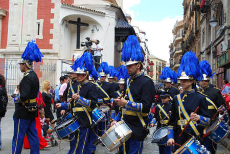semana: Seville, Spain - April 7, 2009 - Members of the San Esteban brotherhood band marching through the city centre streets during Santa Semana, Seville, Seville Province, Andalusia, Spain, Western Europe.