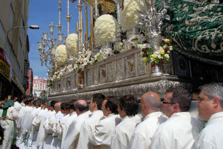 semana: Malaga, Spain - April 5, 2009 - Members of the Pollinca brotherhood carrying the float through the city centre during Santa Semana, Malaga, Malaga Province, Andalusia, Spain, Western Europe. Editorial