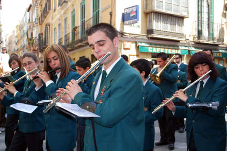 semana: Malaga, Spain - April 5, 2009 - Members of the Pollinca brotherhood marching band walking through the city centre during Santa Semana, Malaga, Malaga Province, Andalusia, Spain, Western Europe.