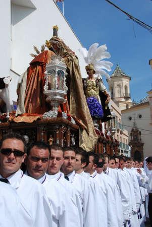 semana: Malaga, Spain, - April 5, 2009 - Members of the Salutation brotherhood walking through the city streets carrying the float during Santa Semana week, Malaga, Malaga Province, Andalusia, Spain, Western Europe.