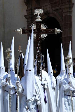 carrying the cross: Malaga, Spain - April 5, 2009 - Members of the Salutation brotherhood walking through the city streets during Santa Semana week, Malaga, Malaga Province, Andalusia, Spain, Western Europe.