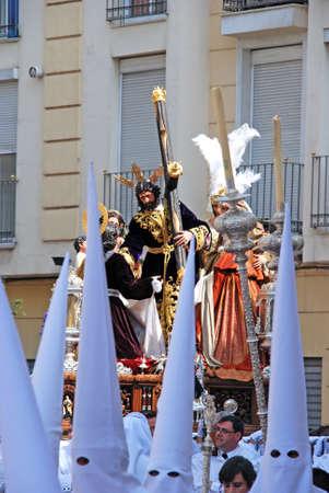 semana: Malaga, Spain - April 5, 2009 - Members of the Salutation brotherhood walking through the city streets ahead of the float carrying Christ during Santa Semana week, Malaga, Malaga Province, Andalusia, Spain, Western Europe. Editorial