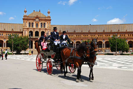 horse drawn: Seville, Spain - April 12, 2008 - Horse drawn carriages in the Plaza de Espana, Seville, Seville Province, Andalusia, Spain, Western Europe.