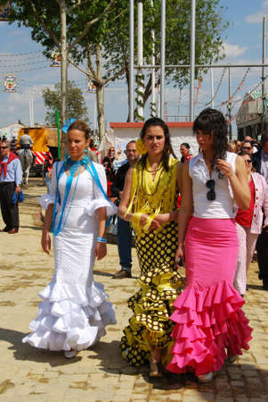 Seville, Spain - April 12, 2008 - Three women walking along the street in traditional dress at the Seville Fair, Seville, Seville Province, Andalusia, Spain, Western Europe. Editorial