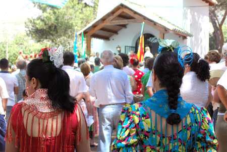 plaited: Spanish women wearing flamenco dresses showing their plaited hair with accessories during the Romeria San Bernabe, Marbella, Costa del Sol, Malaga Province, Andalusia, Spain, Western Europe.