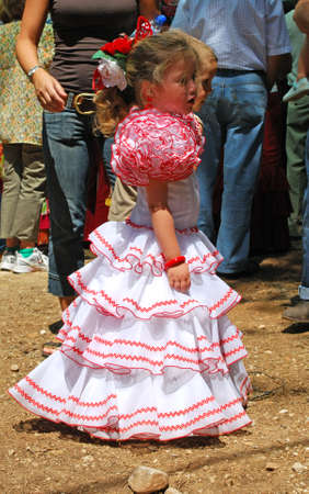flamenco dress: Young girl in a flamenco dress at the Romeria San Bernabe, Marbella, Costa del Sol, Malaga Province, Andalusia, Spain, Western Europe.