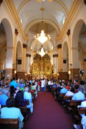 Congregation inside the church (Iglesia de la Encarnacion), Marbella, Costa del Sol, Malaga Province, Andalusia, Spain, Western Europe.
