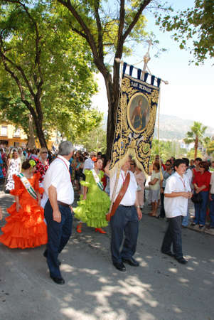 bearer: Flag bearer leading the procession during the Romeria San Bernabe, Marbella, Costa del Sol, Malaga Province, Andalusia, Spain, Western Europe.