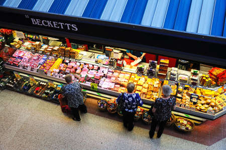 derbyshire: Elevated view of a butchers market stall inside the restored Victorian Market Hall, Derby, Derbyshire, England, UK, Western Europe.