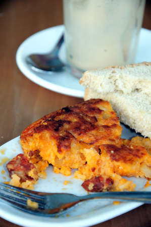 western europe: Piece of Spanish tortilla with chorizo sausage and slices of bread, Andalusia, Spain, Western Europe.