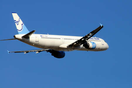 azur: Aigle Azur Airbus A321 taking off against a blue sky. Editorial